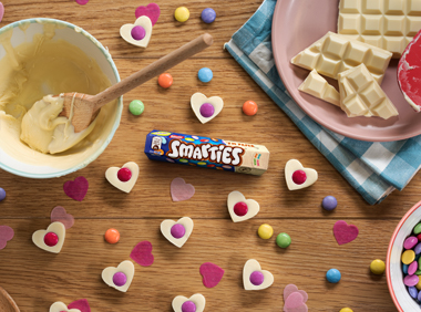 SMARTIES® White Chocolate Hearts on a table