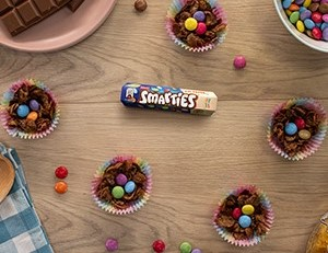 SMARTIES® Easter Egg Nests sat on table