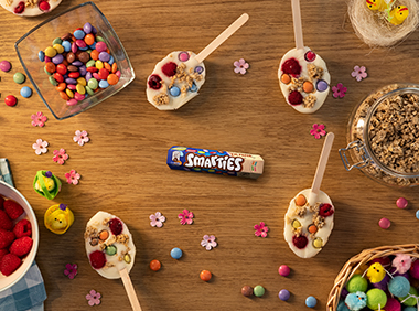 SMARTIES® Easter egg frozen yoghurt lollies on a plate