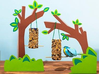 Bird Feeders hanging in paper trees with paper bird